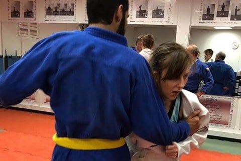 Two people participating in judo