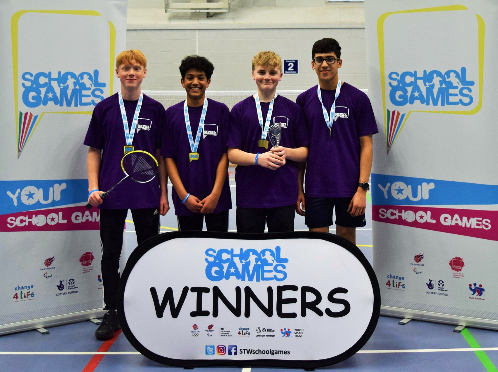 Adams win badminton