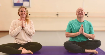2 people in seated yoga position