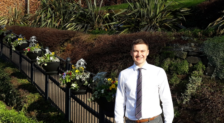 Harry pictured next to flower beds in the Dingle in the Quarry Shrewsbury