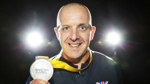 Paul with invictus medal