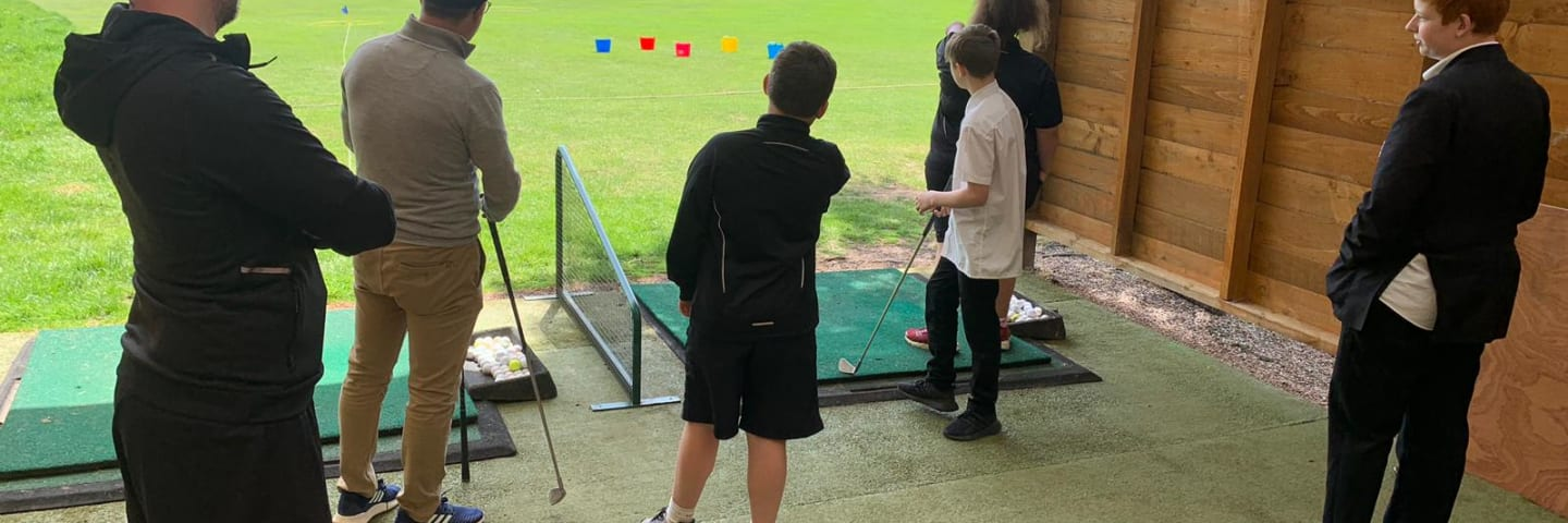 Mark coaching young people at golf