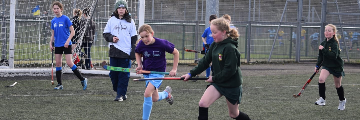 Secondary school pupils playing hockey at the School Games