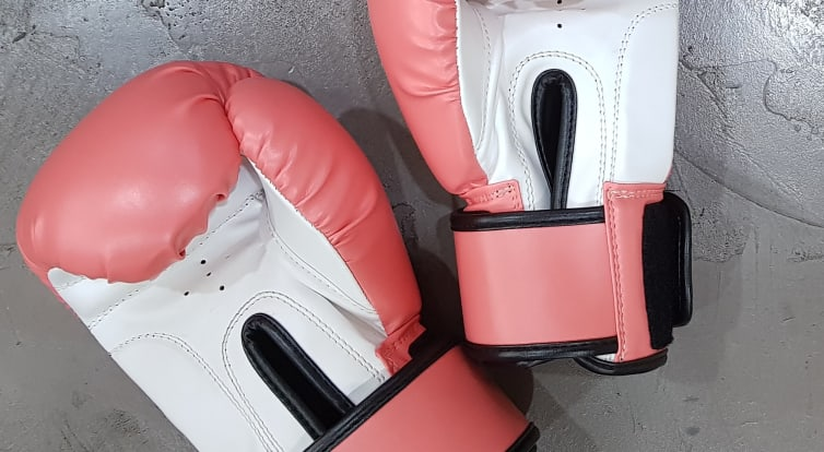 Boxing gloves lay on the floor