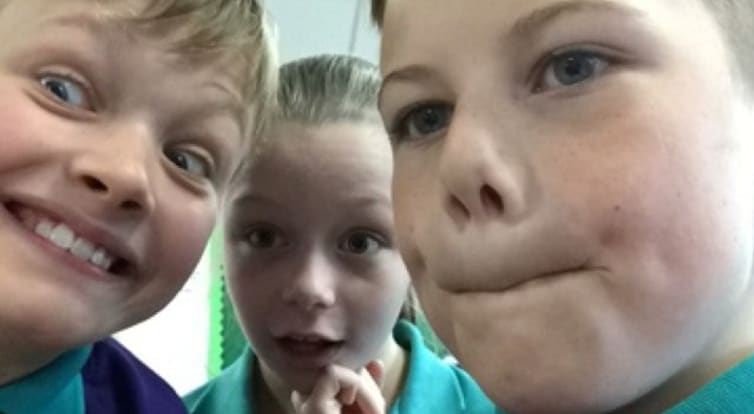 A selfie of three primary school students involved in the Tech-Know Trail